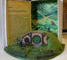 Hobbit House byshinynewthing - Based on instructions from the Games Workshop Lord of the Rings wargame, and featuring Citadel miniatures of Gandalf and Bilbo (painted by my husband). Set in a paper mache book.