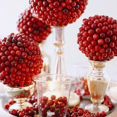 cranberry topiaries Yes, you will need a foam ball from the craft store to assemble these red jewel-like beauties, but it's well worth the trip. To create these glam topiaries, simply use toothpicks to secure cranberries to the foam shape of your choice - we like spheres and cones best.