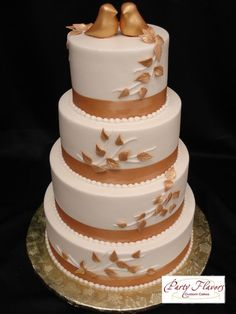 Let doves fly with this gorgeous copper and white wedding cake, complete with copper doves topper. @PartyFlavors #PartyFlavors
