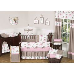 Complete the look of your nursery with this sweet Pink Mod Elephant 9-piece crib bedding set from Sweet Jojo Designs. The bet includes the bedding and decorative elements such as a dust ruffle, a toy bag, a decorative throw and much more.