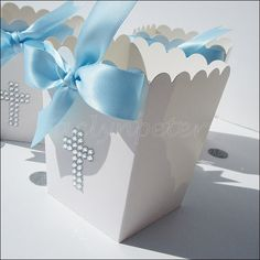 Silver rhinestone cross popcorn favor boxes with baby blue bows are hand made, one at a time, just for his Baptism or Christening celebration. Display at your dessert table or fill with take home trea