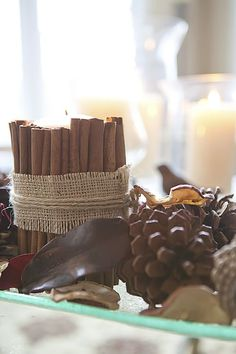 Cinnamon wrapped candles.. wrapped with burlap and tied with butchers twine. <3