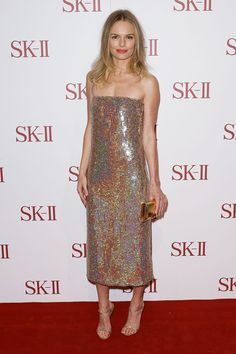 ate Bosworth Strappy Sandals  Clearly Kate Bosworth loves sparkle—among her shimmering sheath, gold clutch, and glittery shoes, there's nothing on her body without shine!