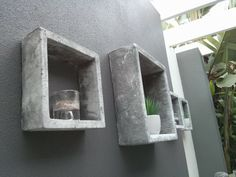 Love the idea of these concrete hanging blocks to put things in. Give just the slightest industrial look, without going overboard with it! Like the idea of using these for toilet roll holders? (see similar pic about that)
