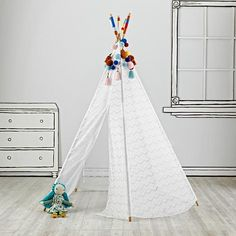 Shop Lace Teepee with Garlands. Everything looks better in lace. That& why we adorned this teepee with lace. This five-sided teepee includes colored poms and yarn decoration at the top, making it as elegant as it is playful. Teepee Kids, Teepee Tent, Teepees, Tents, Tent Living, Kids Play Area, Little Girl Rooms, Baby Store, Play Houses