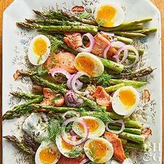 Roast the asparagus and salmon all on one sheet pan for a low-stress yet classy brunch recipe. Not a fan of runny yolks? Try this same dish with hard-boiled eggs.