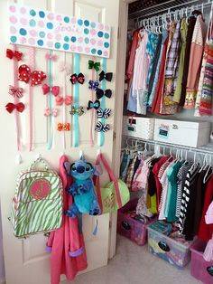 hanging purses and bags on door in Sarah's closet