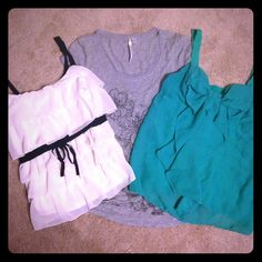LC Lauren Conrad Top Bundle 3 LC Lauren Conrad Tops: cream and green tanks both size medium and the grey t-shirt is a size small. All three would fit a medium or small just fine. They all hit right at the pants level on my long torso which is just a bit shorter than I would prefer. EUC no snags or stains. Re-Poshing. Smoke free home. No Trades/PayPal. Price fairly firm. LC Lauren Conrad Tops Tank Tops