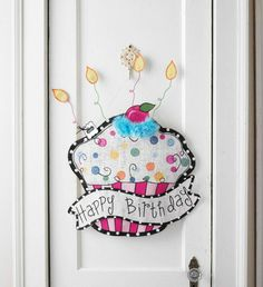 """Cupcake Door Hanger - Hand painted burlap cupcake with """"Happy Birthday"""" banner attached features dimensional wire candles. Hangs from wire."""
