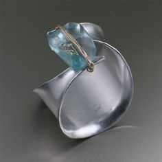 Hand-made Anticlastic Aluminum Cuff with Faceted Blue Quartz Gemstone  http://www.handmade-contemporary-jewelry.com/