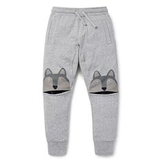 100% Cotton French Terry Track Pant. Features novelty printed wolf at knee. Elasticated cuffs and waistband with functional drawcord. Regular fitting silhouette with slightly tappered leg. Available in Patchy Marle.