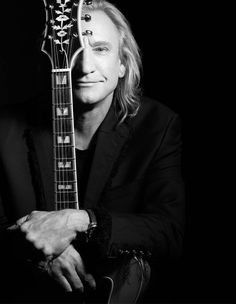 Joe Walsh, love his music can make me smile, and also cry at the lyrics. Lovely man. Glad he's found himself now.