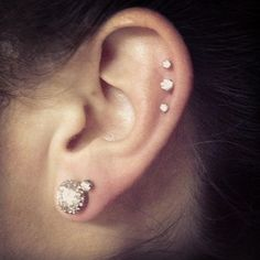 triple cartilage and double earlobe piercing <3