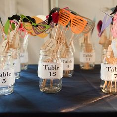 Silly mustaches and glasses for each table kept the atmosphere light and fun. Image Credits: Hitched Studios
