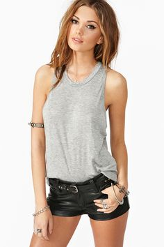 Super soft marled gray tank featuring a high scoop neckline and deep-cut armholes. Slouchy fit. Looks rad paired with moto leggings and stacked bangles!