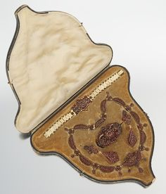 ThisVictorian Garnet Parure in Original Boxsold atAspire Auctions--the case adds to the value, and is often a thing of beauty itself.