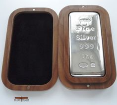 Sheffield Hallmarked 1 kilogram silver bullion bar in a Handmade limited edition Walnut Case, Autographed and serial numbered by the maker.