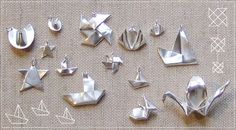 origami jewelry fashioned with a silver sheet and folded into origami cranes, windmill and so much more!