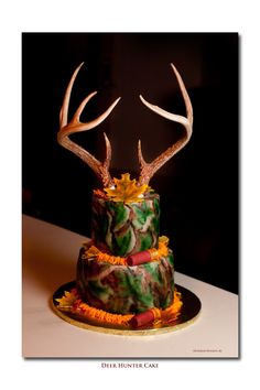 Hunter's Birthday Cake - Airbrushed buttercream icing, Antlers are real and mounted in a dummie cake. Shotgun shells are fondant/gumpaste covered rice krispie treats. Leaves are 50/50 also.