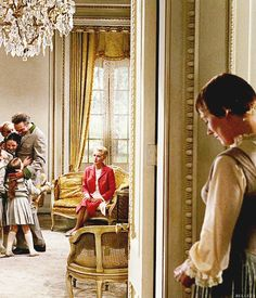 The Sound of Music - Maria watches the Captain, the children and the Baroness through an open door.