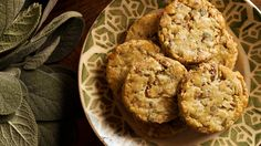These little cookies are packed with savory flavors — black pepper, fresh sage and Parmesan — and are studded with chopped pecans An ideal nibble with a glass of dry sherry or a cocktail, they are also welcome on a cheese board.