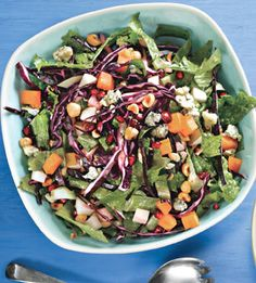Rainbow Chopped Salad from bon appetit, featuring red cabbage, three fruits, pomegranate seeds, blue cheese, and a red wine vinegar dressing. Yum.