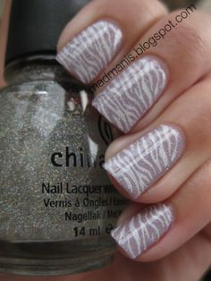 started with 2 coats of sally hansen delphinium. Then I stamped over it with plate BM223 and Konad special polish in white. I think I like this zebra print more than the Konad one. Topped with two coats of China Glaze Fairy Dust and a coat of Seche Vite.