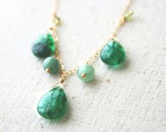 Green Necklace, Gemstone Jewelry, Spring Jewelry  These crisp green chrysoprase gemstones are perfect for a blast of color in your wardrobe! Seven lucky stones are paired with a waterfall of gold filled chain for a unique statement necklace.  + Chrysoprase Gemstones. 14K Gold Fill Chain. Lobster Clasp. + Necklace measures 18 inches (45.7 cm) in length, with a 1.25 inch (3.1 cm) drop. + Necklace takes 1-2 business days to make. + Your jewelry will come in a jewelry box, tied with our…