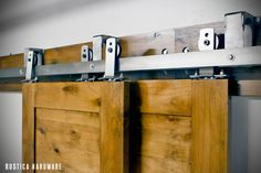 By-Pass Barn Door Hardware allows up to 3 doors to slide in front or in back of each other.