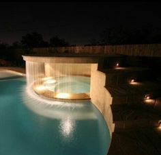 Backyard - Hot Tub & Swimming Pool complete with Waterfall. The landing could use a Roman Style Gazebo too! #SaltWater