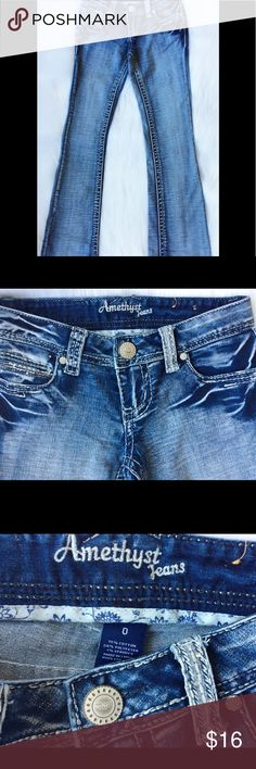 """Amethyst """"Gladys"""" Bootcut Jeans Amethyst """"Gladys"""" Bootcut Jeans, size 0. Measurements approx. (please see Amethyst size chart above) 24"""" W x 33"""" L. Feature med.-dark wash, embellished detailing, heavy stitching, embroider back buttoned pockets, white label. Amethyst Jeans Jeans Boot Cut"""