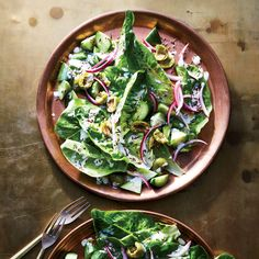Romaine Salad with Cracked Olives and Salted-Lemon Yogurt | Chef Biju Thomas calls this Romaine Salad with Cracked Olives and Salted-Lemon Yogurt an Indian-Greek salad, matching crunchy vegetables with a zingy dressing. Get the recipe at Food & Wine.