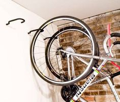 If you don't have enough room in your garage, basement or storage area to build a ton of shelving, consider hanging hooks from the ceiling so you can dangle large objects (like bikes or golf bags) off the ground.
