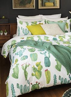 Exclusively from Simons Maison One of home fashion's most popular motifs, cacti evoke sizzling desert landscapes and boho-inspired California decor. Welcome them into your urban-themed rooms for a look straight out of a Brooklyn loft! The set includes: Twin: 1 duvet cover 66&quote; x 90&quote;, 1 pillow sham 20&quote; x 26&quote; Double: 1 duvet cover 84&quote; x 90&quote;, 2 pillow shams 20&quote; x 26&quote; Queen: 1 duvet cover 90&quote; x 95&quo...