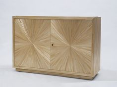 We at Atelier Viollet are pleased to share with you one of our more recent creations, a cabinet in straw, commissioned by Fawn Galli Interiors.