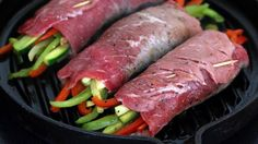 Tender steak rolls filled with zesty vegetables and drizzled with a glaze that is simply out-of-this-world delicious.