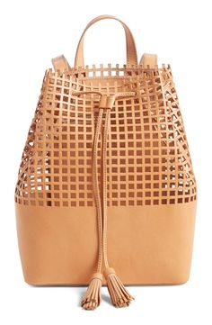 Square perforations lend a cool, urban aesthetic to this compact drawstring backpack from Loeffler Randall.