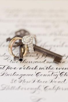 Skeleton keys give such a vintage classic look and goes well with that halo ring ;) We so have to take a picture like this!