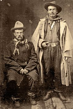 23 Definitive Drovers (Opposite Page) Working cowboys engaged in trailing longhorns to markets or to a new range, these drovers appear to date to the 1870s. They have not yet adopted traditional cowboy clothing and are wearing military frock coats, pinstriped pants and nondescript hats. The cowboy on the right held up his pants with a military belt and buckle. – Courtesy Robert G. McCubbin Collection –