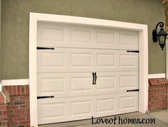 Sally at loveofhomes.com says these hardware kits can be found at Home Depot for around $20. Gives standard door a carriage house look.