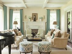 Cream Black Dusty Turquoise.  I love the furniture in this living room a lot!  Its very comfy looking but very elegant at the same time.  Soft spot for that glossy black grand piano!  Takes me back to my musical prodigy type days :P