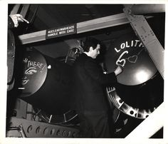 """Stanley Kubrick drawing Lolita's sunglasses on nuclear warhead on the set of """"Dr. Strangelove or: How I Learned to Stop Worrying and Love the Bomb""""] Photo by Weegee"""