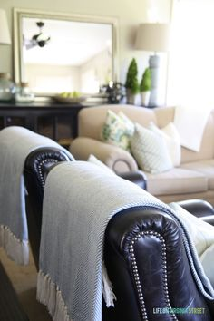 Easy way to lighten up dark leather chairs or couches - love this blanket (and it's so affordable too)!