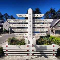 "Native American inspired ""totem-style"" way finding signage for The Hidden Coast Scenic Byway (aka Highway 109).  This is located in Seabrook, WA.  Designed by landscape designer, Stephen Poulakos."