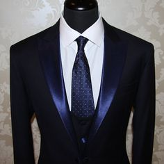 Black tuxedo with navy blue lapels. A nice switch-up to the classic tuxedo