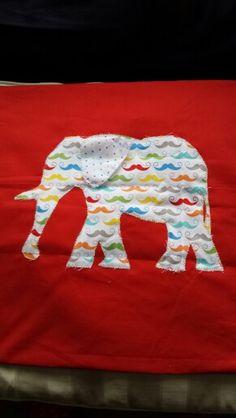 Applique elephant cushion cover.