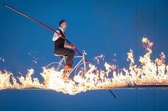 Jade Kindar-Martin, world famous high-wire walker and his unique daredevil Fire-Wire walk. Here on the bicycle at the Calgary Stampede Stampede 2017, World Famous, World Records, Daredevil, Calgary, Cool Pictures, Jade, Bicycle, Unique