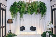 The photography backdrop for Mamin and Filza's reception. #wedding #garden #foliage