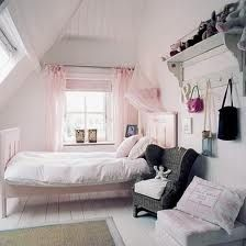 Cute attic bedroom.  White painted everything + light pink sheers + black wicker chair + pink & black accents