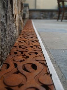 Seattle-based Iron Age Designs Ruqaiyah 2 recycles engine blocks and brake drums to create cast-iron drainage grates like no other Urban Landscape, Landscape Design, Architecture Details, Landscape Architecture, Drainage Grates, Trench Drain, Design Jardin, Iron Age, Textures Patterns